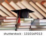 graduation hat and stacks of...   Shutterstock . vector #1310169313