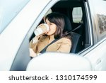 young woman driving car. safety ...   Shutterstock . vector #1310174599