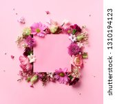 Stock photo frame of pink flowers over punchy pastel background valentines day woman day concept spring or 1310194123