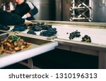 people working in a winery... | Shutterstock . vector #1310196313