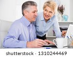 mature man and woman watch... | Shutterstock . vector #1310244469