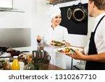 glad female cook in uniform... | Shutterstock . vector #1310267710