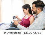 cute mid adult couple holding... | Shutterstock . vector #1310272783
