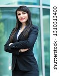 smiling businesswoman outdoor | Shutterstock . vector #1310313400