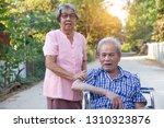 senior couple woman caring man...   Shutterstock . vector #1310323876