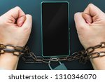 hands tied with a chain ... | Shutterstock . vector #1310346070
