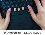 women's hand on the laptop... | Shutterstock . vector #1310346073