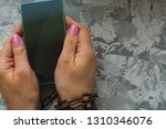 hands tied with a chain ... | Shutterstock . vector #1310346076