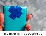 smartphone in hand with camera... | Shutterstock . vector #1310350576