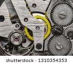 gears of a mechanical watch... | Shutterstock . vector #1310354353
