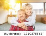 happy senior couple smiling on... | Shutterstock . vector #1310375563