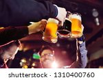 friends   young cute men drink... | Shutterstock . vector #1310400760