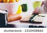 cutting a cucumber on wooden... | Shutterstock . vector #1310408860