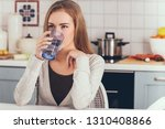 woman sitting in kitchen and... | Shutterstock . vector #1310408866