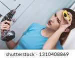 young woman with cordless and... | Shutterstock . vector #1310408869