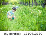 cheerful kid holding basket... | Shutterstock . vector #1310413330