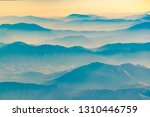 aerial view from window plane... | Shutterstock . vector #1310446759
