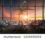 airplane departure  at sunset | Shutterstock . vector #1310450353