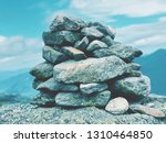 a pile of stones become a cairn ... | Shutterstock . vector #1310464850