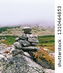 a pile of stones become a cairn ... | Shutterstock . vector #1310464853