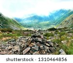 a pile of stones become a cairn ... | Shutterstock . vector #1310464856