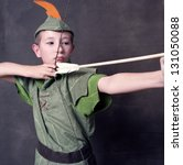 Young robin hood drawing a bow...