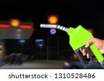fuel nozzle hand holding red... | Shutterstock . vector #1310528486