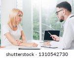 male doctor is talking to...   Shutterstock . vector #1310542730
