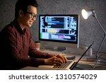 cheerful asian software... | Shutterstock . vector #1310574029