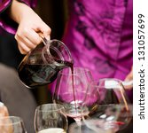 red wine pouring into a wine... | Shutterstock . vector #131057699