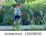 first steps of cute baby boy on ... | Shutterstock . vector #131058230