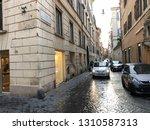 a taxi travels down an italian...   Shutterstock . vector #1310587313