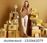 trendy shopper woman in gold... | Shutterstock . vector #1310662079