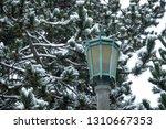 tarnished copper streetlamp in... | Shutterstock . vector #1310667353