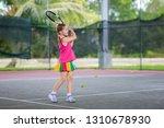 child playing tennis on indoor...   Shutterstock . vector #1310678930