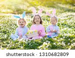 easter egg hunt in spring... | Shutterstock . vector #1310682809