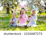 kids with bunny ears on easter... | Shutterstock . vector #1310687273