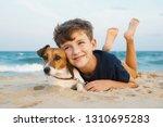 happy boy hugging his dog breed ...   Shutterstock . vector #1310695283