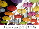 many multiple colors umbrella... | Shutterstock . vector #1310727416