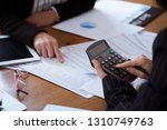 business woman accounting... | Shutterstock . vector #1310749763