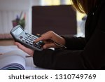 business woman accounting... | Shutterstock . vector #1310749769