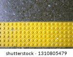 close up yellow braille block... | Shutterstock . vector #1310805479
