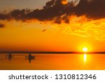 Dramatic Sunset With Fishermen...