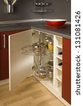 Stock photo detail of a circular open kitchen cabinet with cans of beans 131081426