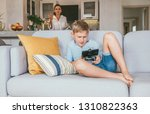 boy plays with electronic... | Shutterstock . vector #1310822363