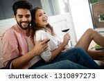 beautiful couple is smiling and ... | Shutterstock . vector #1310897273