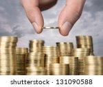 Savings  Close Up Of Male Hand...