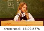 math lesson. small kid at math... | Shutterstock . vector #1310915576