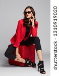 fashion young woman in red... | Shutterstock . vector #1310919020