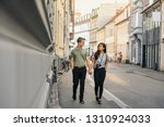 young couple holding hands and... | Shutterstock . vector #1310924033